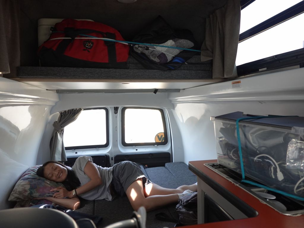 luggage on top, and the 2 benches transformed into a space big enough to sleep 2