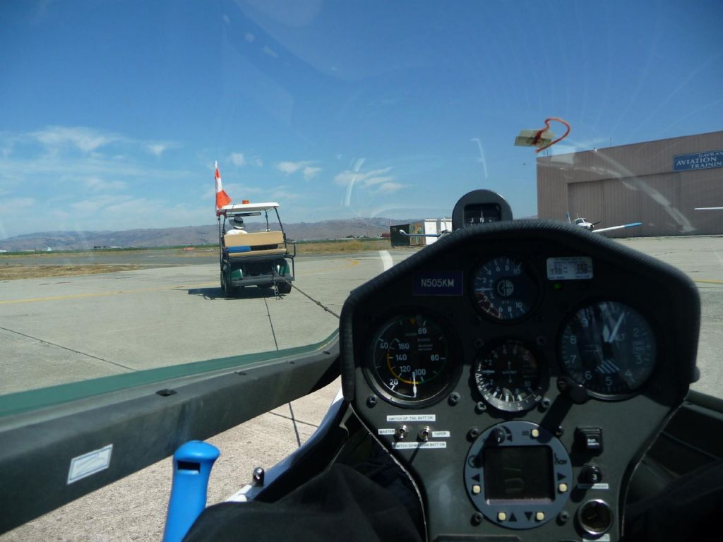golf car tow to the runway