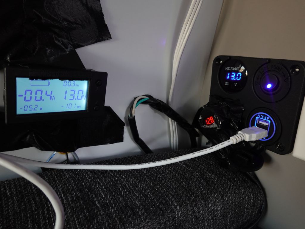 our Kuga had been upgraded with a 12V and USB plug coming from the battery, my inverter meter is on the left. The 12V plug there was only good for 10A though, so you can't use it for an inverter