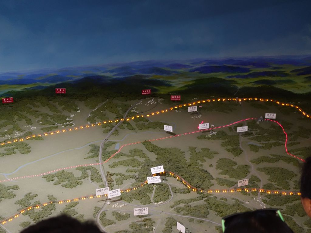 the DMZ is the no man's land area between the 2 yellow lines, with the border in red in the middle