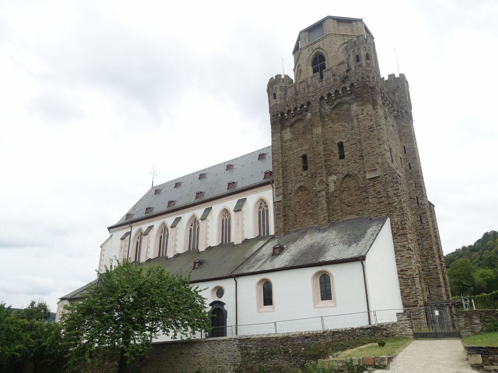after this city wall tower went unused, that church stole in and grafted itself onto it :)