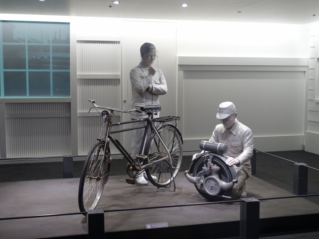 before making cars, toyoda made a bike helping motor