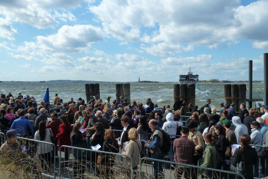 line of people going to the statue of liberty