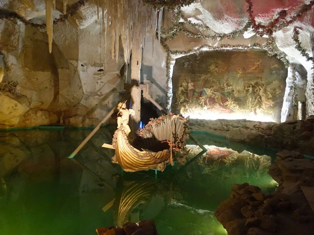 the guy built his own grotto with water, boat, and mural...