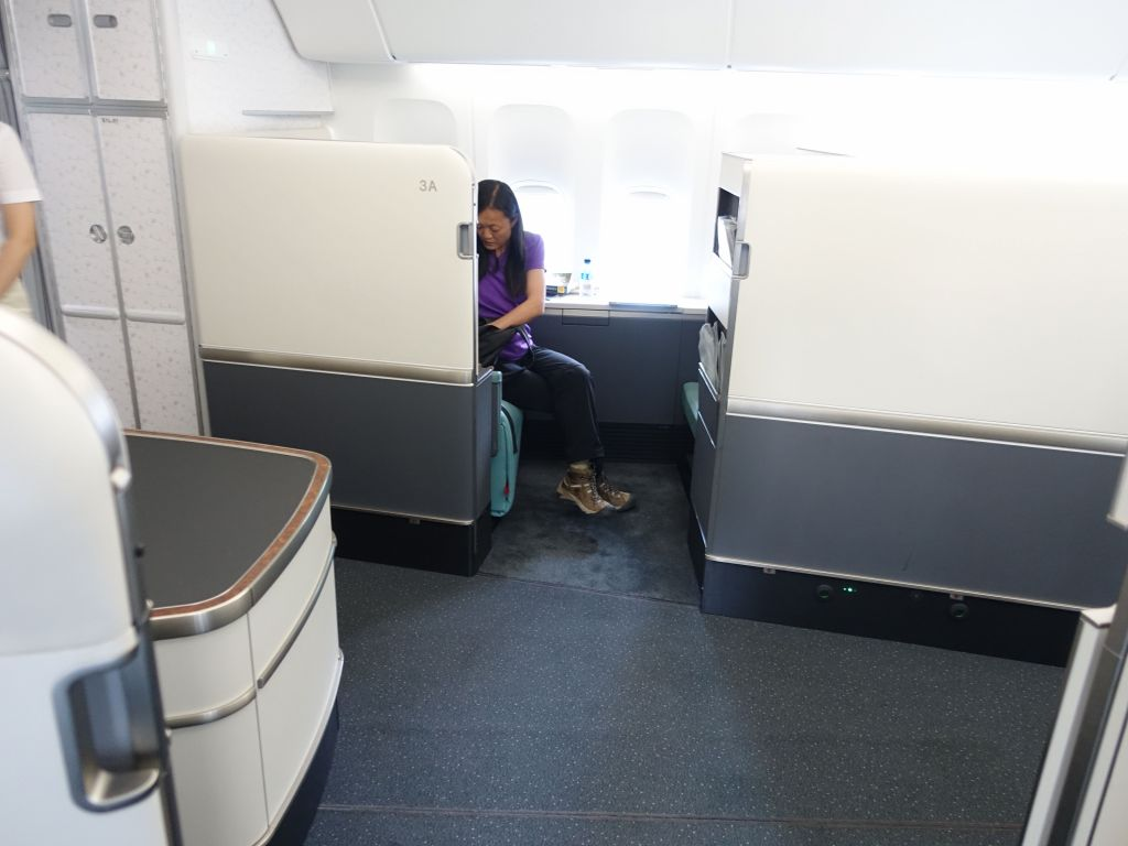 Jennifer was far across the aisle with lots of empty space in the middle, but they later moved her because her entertainment system didn't work