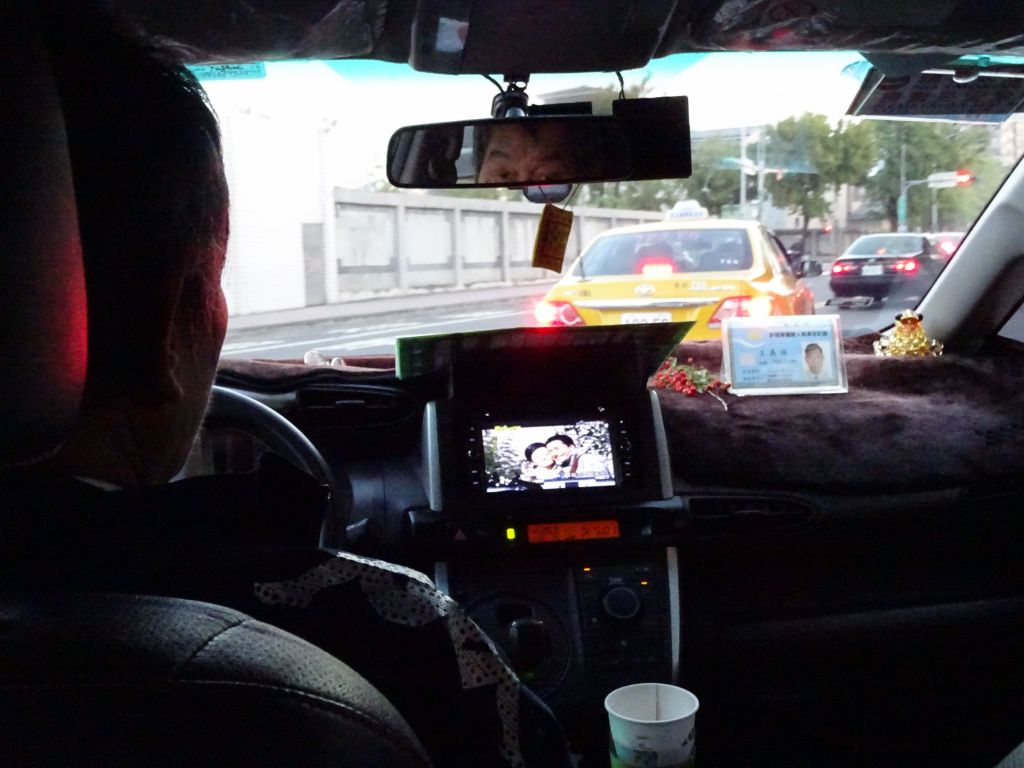driving a cab is less boring if you can watch TV at the same time