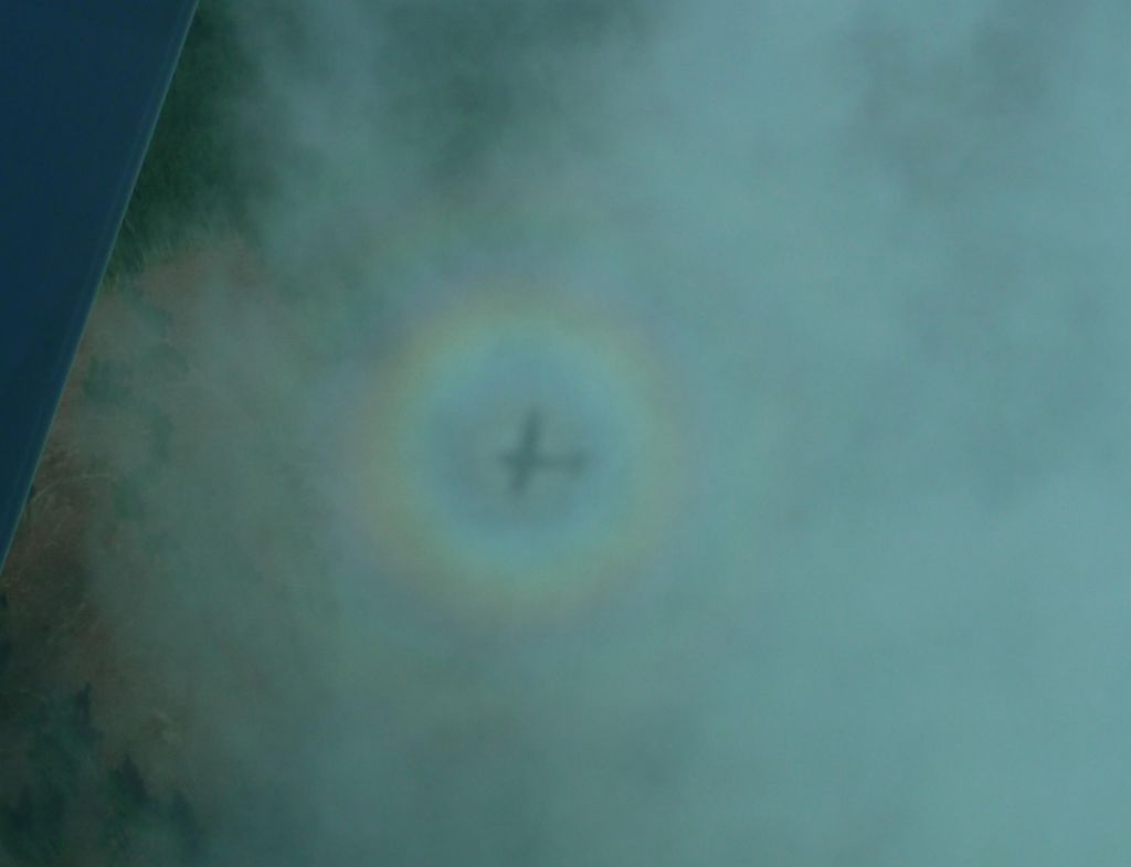 cool shadow of our plane in the clouds with a rainbow around it. Neat!