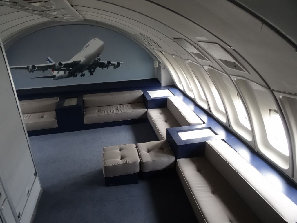older planes had a salon on the 2nd floor, omg...