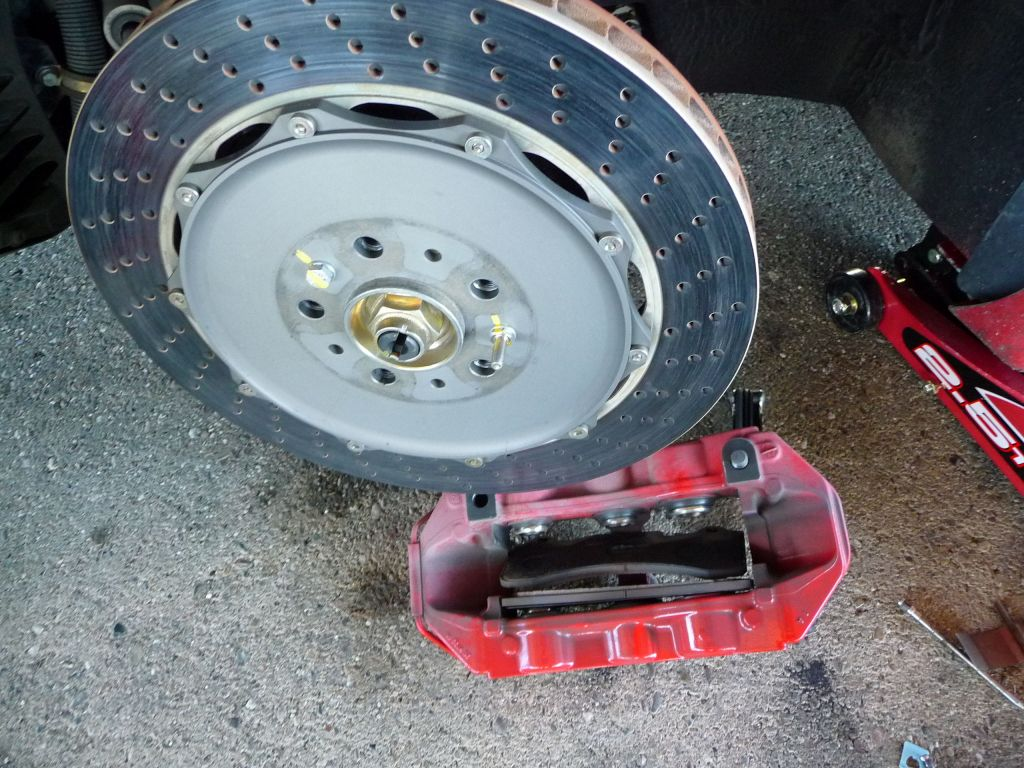 The big bolts had to be taken out and the caliper split in two