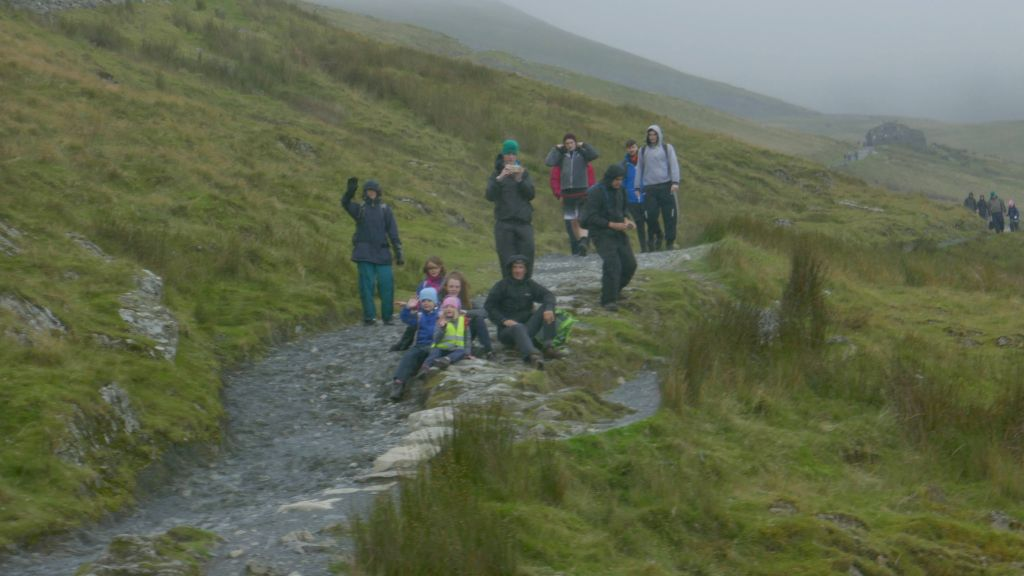 poor hikers who did all this in the rain for no views